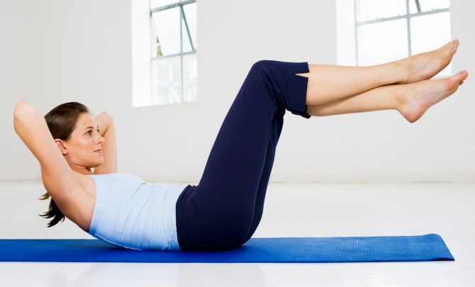 Woman demonstrating how to strengthen core.