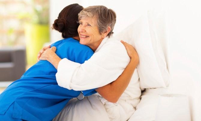 Patient hugs caregiver.