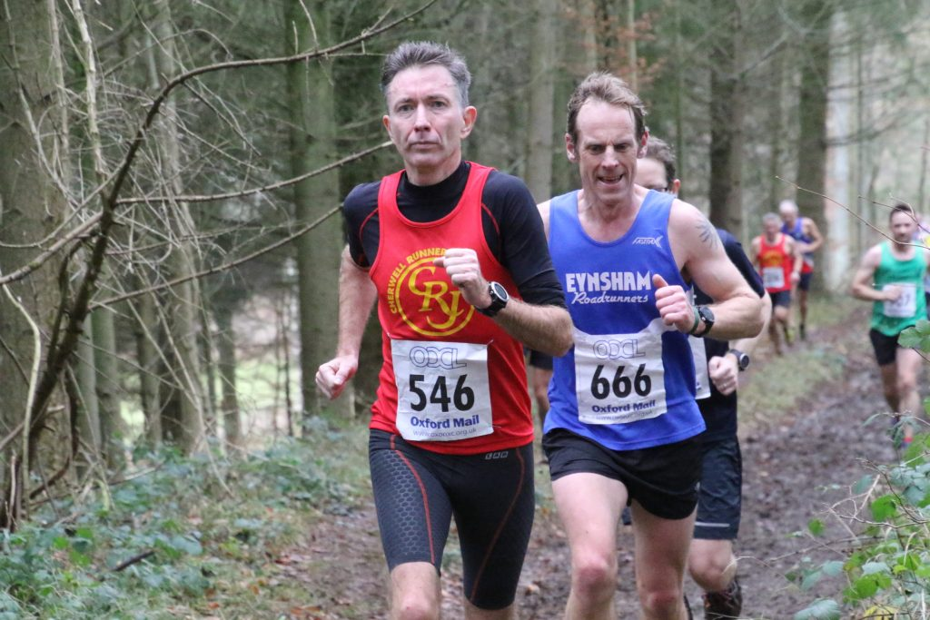Determined runner in the muddy woods at Cirencester Cross Country, last lap