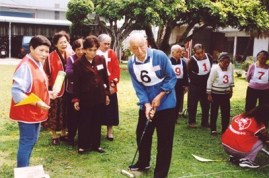 Clients of Miracle Place enjoy a game of croquet.