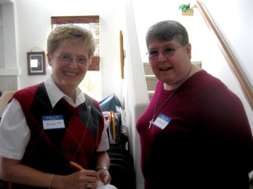 Sisters Diane Mason (left) and Cathy White smile for the photographer prior to the orientation held in Coachella, Calif., on Saturday, Dec. 3, 2011.