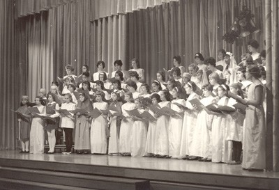 Students in grades five through eight sing Christmas songs at Dunblane School, Washington, D.C., circa 1965.