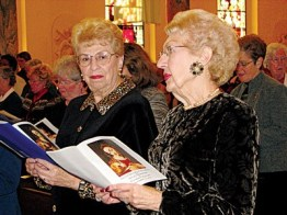 Sister Laurette Bellamy (left) and her friend, Marian Krajewska of Bloomington, Ind., participate in the Rite of Commitment. Sister Laurette served as Marian's companion.