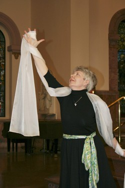 Sister Marsha Speth performs a liturgical dance during a small celebration after the announcement.