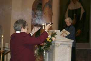 Sister Betty Hopf carries incense to the altar during the celebration.
