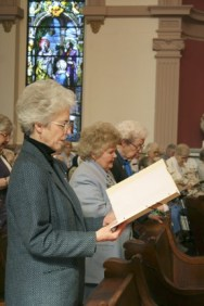 Sisters of Providence rejoice with song at the announcement.