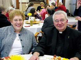 Father Daniel Hopcus and his companion, Sister Paula Damiano, smile for the camera during the reception.