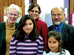 Annmarie Portela (center, back row) celebrates with her family and Sister Ellen Cunningham (back row, left).