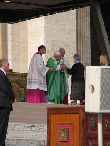 Pope Benedict XVI gives communion to Sister of Providence Mary Lois Hennel.