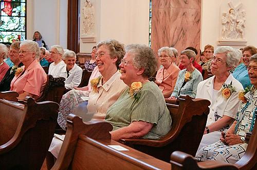The jubilarians enjoy Sister Denise's remarks.