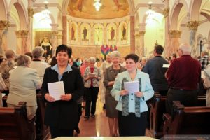 Sisters Dina Bato and Regina Gallo are all smiles as they process out at the end of Mass.