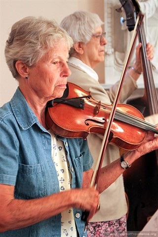 Sister Jacquelyn Hoffman shares her violin skills with the congregation.