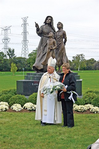 Providence Associate and artist Teresa Clark and Cardinal Francis George, OMI, Archbishop of Chicago, stand in front of the Saint Mother Theodore Guerin statue that Teresa created. The statue was dedicated on Sept. 29, 2009, at the All Saints Cemetery in Des Plaines, Ill.