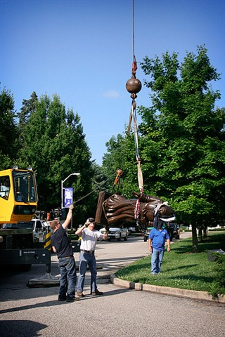 Mother Theodore is secured, attached to crane, and lifted from the truck.