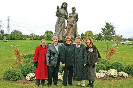 Helping Teresa Clark celebrate the dedication of her Mother Theodore Guerin statue at All Saints Cemetery are some Providence Associates and one Providence Candidate-Associate. From left to right are Providence Associates Carol Passmore, Marilyn Neuman, Teresa Clark; Sister Diane Mason, assistant director of Providence Associates; and Providence Candidate-Associate Mel Wolff.