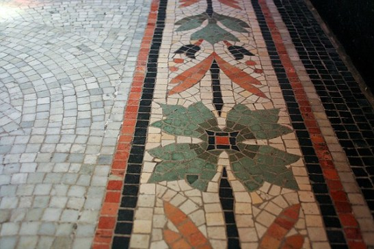 The floor of Saint Anne Shell Chapel has pretty floral patterns on the tile floor.