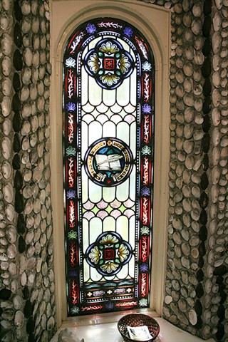Both windows, dedicated to Saint Anne, show motifs of books and writing quills.