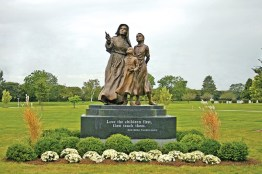 "This is the front of the statue with Mother Theodore's famous quote, ""Love the children first, then teach them."""