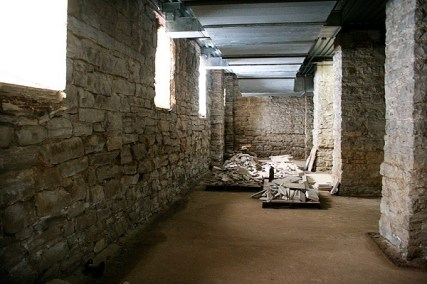 The walls of the crypt are beautiful old stones.