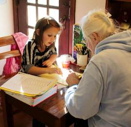 Sister Charles Van Hoy tutors a child after school at Educational/Family Services.