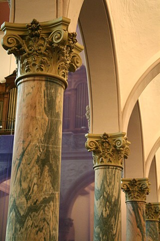 This marble column is in the Corinthian style.