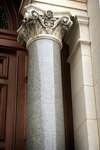 The exterior of the church has Corinthian marble columns as well. The fancy top part of the column is called the capital.