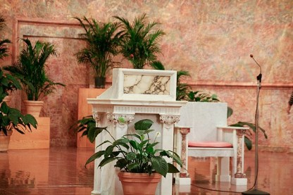 In this picture of the lectern, or podium, you can see many types of marble from all over the world.