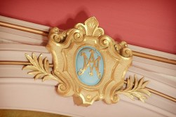 This plaster seal is high above the altar. The letters on it refer to Mary, the mother of Jesus.