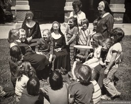 In 1979, Sisters of Providence (left to right) Sisters Francis Joseph Elbreg, Mary Aimee Ward, Mary Damien Rouhier, Richard Bussing and Ann Lee celebrated the International Year of the Child with children from Terre Haute.