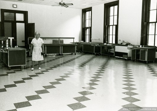 Sister Edith Pfau previewing the new dining room in Providence Hall on July 29, 1983, prior to its Opening Day.
