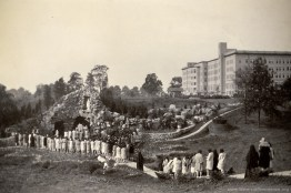 The first Mass at Our Lady of Lourdes Grotto was celebrated Feb. 11, 1928. The grotto was built as a replica of the Lourdes grotto in France. Le Fer Hall, built in 1924, is in the background.