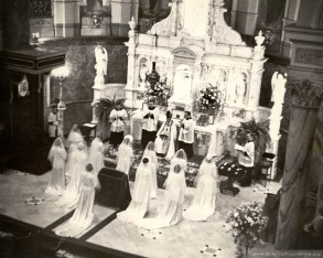 """Prior to 1964 young women who were received into the novitiate of the Sisters of Providence dressed as """"Brides of Christ"""" and received the holy habit (on the table to the right) from the Bishop of Indianapolis. Pictured is the reception band of Aug. 15, 1950."""