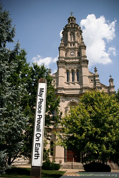 This peace pole, with messages of peace in four different languages covering the faces, is outside the front entrance of the church of the Immaculate Conception. Saint Mary-of-the-Woods, Indiana, is the home of the Sisters of Providence of Saint Mary-of-the-Woods.