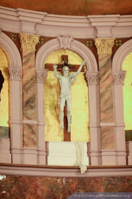 Located up high at the front of the church, the crucifix was sculpted by Harry Breen of Champaign, Illinois. The Church of the Immaculate Conception is on the motherhouse grounds of the Sisters of Providence of Saint Mary-of-the-Woods, Indiana.