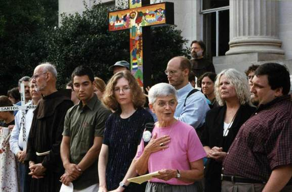Sister of Providence Kathleen Desautels, in the pink, stands on the front courthouse steps on the first day of her trial after being arrested for peacefully protesting at the School of Americas march in Fort Benning, Georgia, several years ago. Sister Kak is featured in the current issue of Rolling Stone magazine.