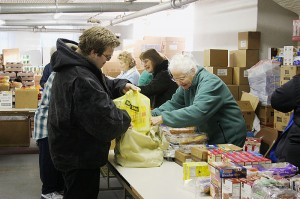 David Franklin packages up the food he has received from volunteer Sister Charles Van Hoy at Providence Food Pantry in West Terre Haute.