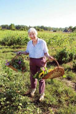 Sister Joan Matthews connects with creation by picking flowers in the gardens at Saint Mary-of-the-Woods.