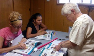 Sister Carol Nolan, at right, teaches English to two of her students at Providence in the Desert in California.