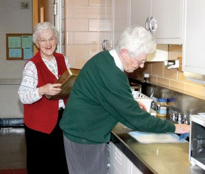 Sister Patty Fillenwarth, left, washes dishes with her sister, Sister Joseph Fillenwarth, as the two finish preparing treats to take to a family gathering.