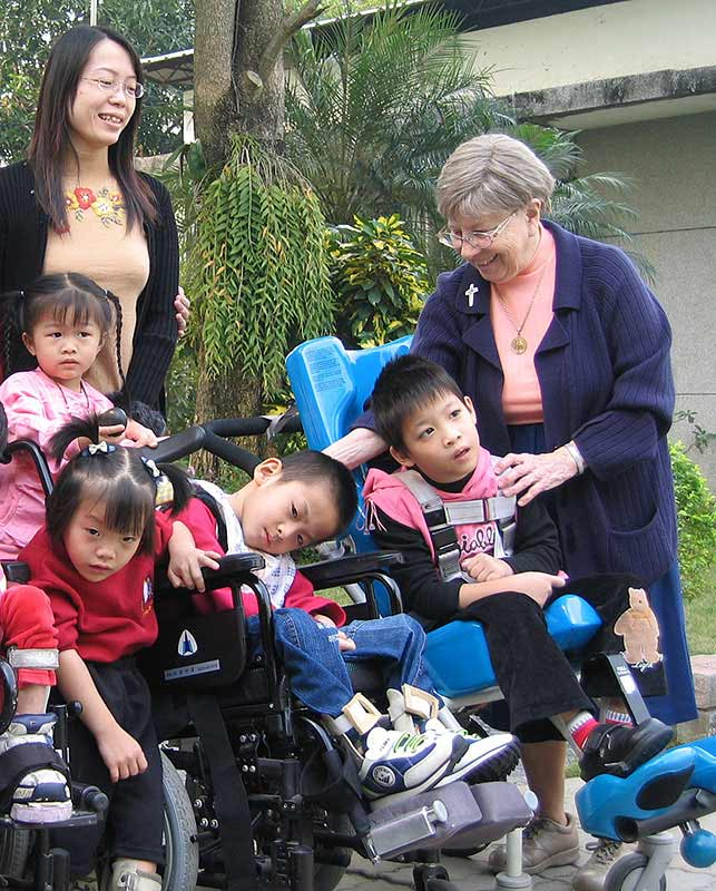 Sister Ruth Sampson works with children at St. Therese Opportunity Center in Taiwan in 2004