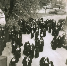 Aug. 16, 1956, 6:30 a.m. Outside of the Express Hall area at Saint Mary-of-the-Woods, sisters say goodbye to those about to board buses for Chicago.