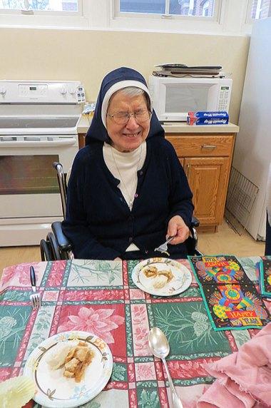 S. Rosalie Weller enjoying her homemade pie.