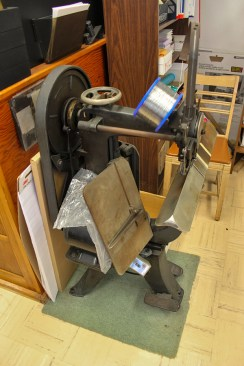 The Printery in Owens Hall still uses this binding machine straight out of the industrial age.
