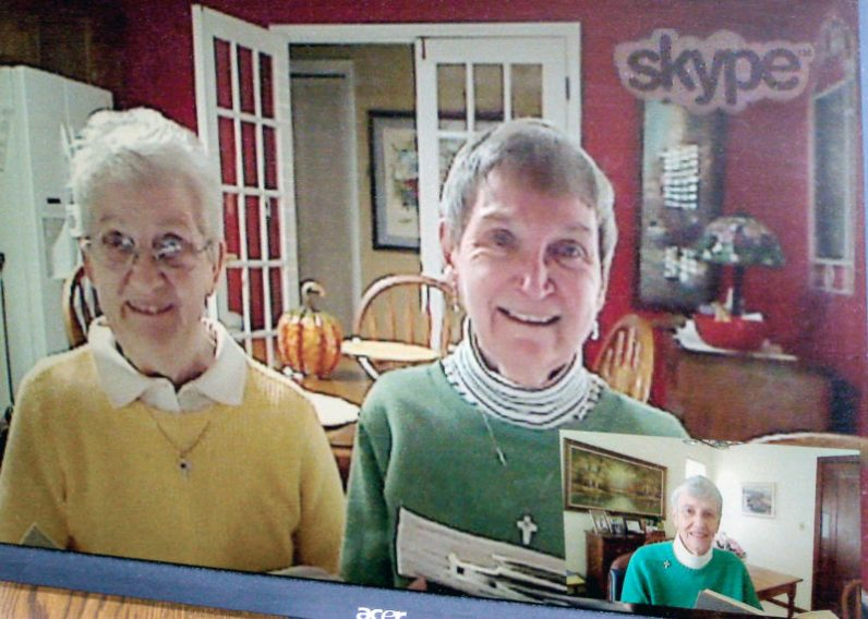 From left, Sisters Eileen and Brigid Ann Bonner in Louisville join Sister Mary Morley in Cincinnati, inset, for daily prayer via Skype.