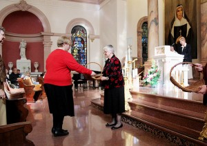 Kaitlyn with Sisters of Providence General Superior Sister Denise Wilkinson during Kaitlyn's commitment ceremony as a Providence Associate in 2013.