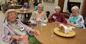Catching up at the Sunday social are, from left, Sisters Lucy Nolan, Marie Paul Haas, Terese Marie Havlik and Providence Associate Judy Jaberg.