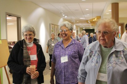 Sisters Nancy Bartasavich, Martha Rojo and Dorthy Larson chat while looking at plans for the under-construction shrine for Saint Mother Theodore Guerin.