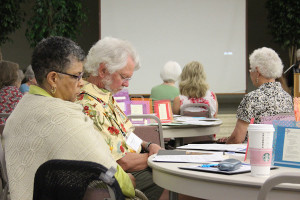 Providence Associates Barbara Cottrell and Bill Adams pause for prayer during a gathering of Providence Associates.