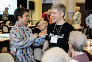 Post author Providence Associate Joan Frisz, center, chats with sisters she has gotten to know better through her Providence Circle, including Sisters Hannah Corbin at left and Eileen Rose Bonner at right during a break time at the Sisters of Providence annual meeting.