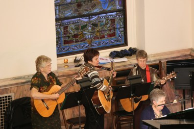 Sister Jenny Howard, Sister Dina Bato and Sister Patty Wallace play their guitars.